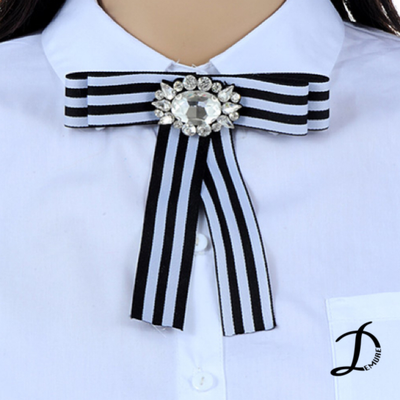 White and black brooch