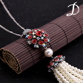 Pearls and red crystal necklace